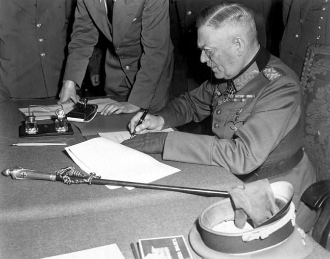 Keitel signing the act of surrender at Berlin, May 8, 1945.