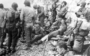 Troops of the 3d Battalion, 16th Infantry Regiment, 1st Infantry Division, Omaha Beach, June 6, 1944.