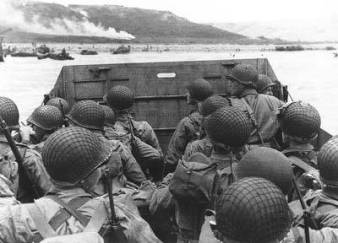 Troops in an LCVP approaching Omaha Beach, June 6, 1944.