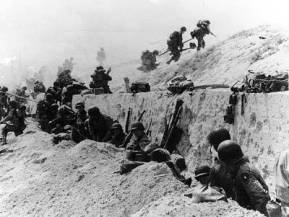 Troops of the 8th Infantry Regiment, 4th Infantry Division on Utah Beach, June 6, 1944.