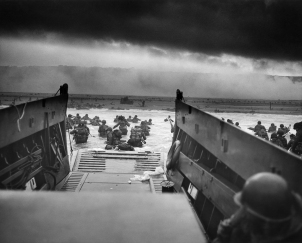 Troops of Company E, 16th Infantry, 1st Infantry Division on the Fox Green section of Omaha Beach, June 6, 1944. During the initial landing, two-thirds of the Company E became casualties.