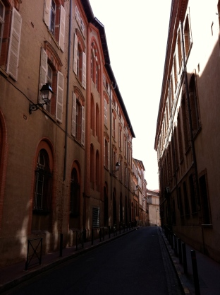 "A typical side street. See why it's called ""la ville rose""?"